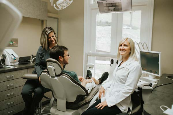 happy dental patient receving restorative dental service at LakeView Dental Arts
